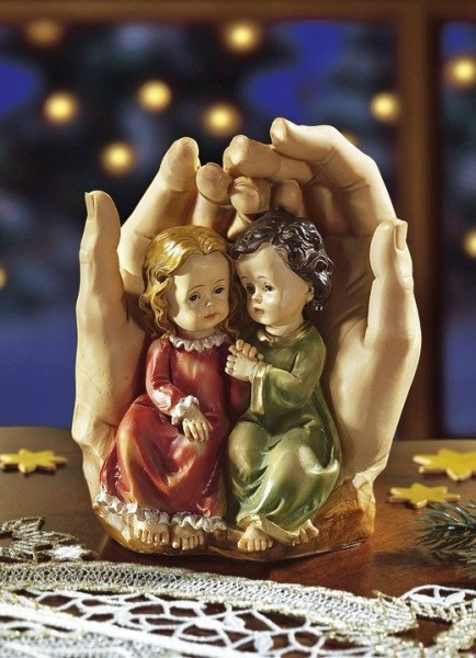 Schützende Hände mit Kinder